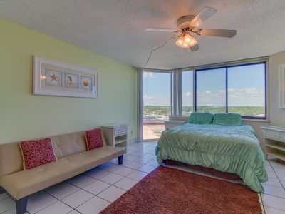 Photo for Beachfront condo with access to pools, fitness, & game room - snowbirds welcome!