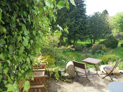 View from the kitchen - your bench in the shade or full sun at the bistro set.