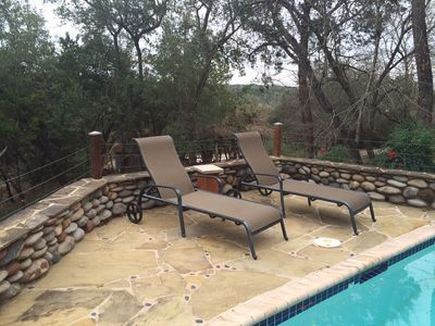 Relax Poolside on the 1.3 Acres of Grounds and your own private pool/Hot Tub/FP!