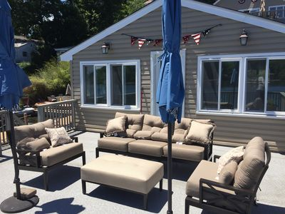 Off the boathouse deck is a 4 season room which features a new Ping Pong table