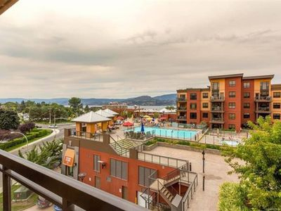 Photo for Bright Corner Unit with Lake and Pool Views