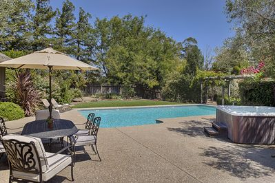 Pool, hot tub, outdoor dining area