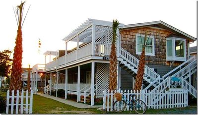 Photo for NEW on the PROACTIVE Vacations Rental Market, this tastefully decorated lower level home offers a lovely canal view porch with swing and a quick & easy walk to the beach!
