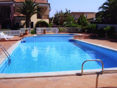 Photo for Apartment in beautiful grounds with shared pool and air conditioning