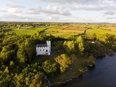 Photo for 13th Century Lakeside Castle in 7 Acres of Park and Woodland