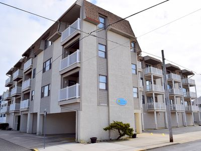 Photo for Elevator access and a deck! Short walk to the beach, restaurants and downtown shopping. Book this unit today!