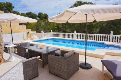 Private pool with lounge set and sunbeds