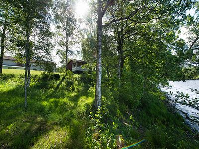 Photo for Beautiful summer house in a secluded lakeside location in the woods