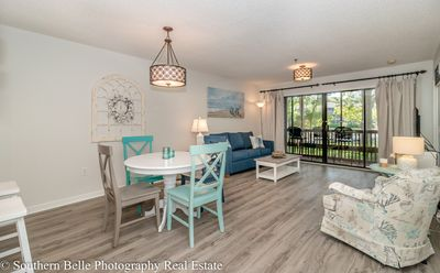 Photo for Newly Renovated.... 2bed/2bath...on lake ...screened porch... Walk to Beach!