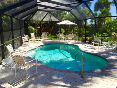 Photo for Tropical Oasis - 3 Minutes to Beach, Heated Pool, 4 Season Living at its Best!