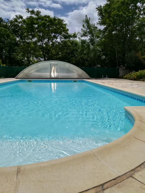 white stone cottage in the countryside, with swimming pool. Magnificent view