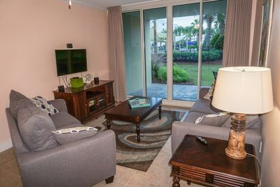 Living area with a palm tree view includes sleeper sofa