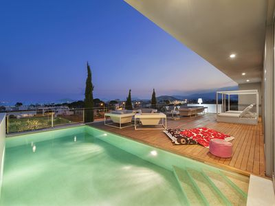 Photo for LUXURY VILLA BOQUER WITH INCREDIBLE VIEWS OF PORT POLLENSA INDOOR & OUTDOOR POOL