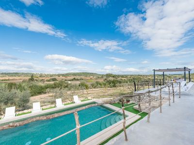 Photo for This 4-bedroom villa for up to 8 guests is located in Sineu and has a private swimming pool, air-con