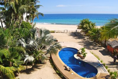 View - Beachfront pool with beach access.