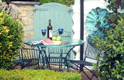 Relax on the patio overlooking the walled garden