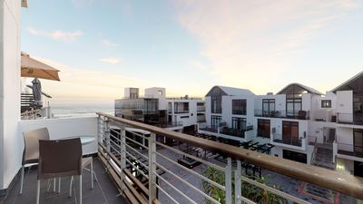 Photo for Elegant beachfront penthouse w/water views & private balcony