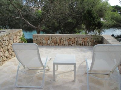 Photo for 'Charo', waterfront apartment with pool, 5 min walk to beach, stunning views