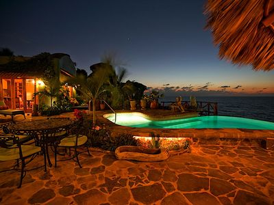 Photo for Amazing house in magical location, oceanfront, 4 bedrooms, with on site staff.