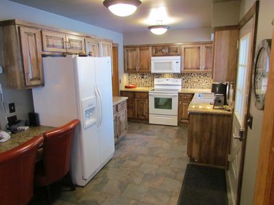 Kitchen:  Remodeled in 2011; new appliances, quartz countertops, fully furnished