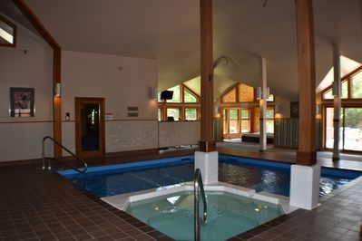 pool in amenity building , sauna and hot tub plus Jacuzzi and pool table