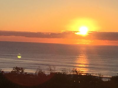 Watch the sun rise over the waves