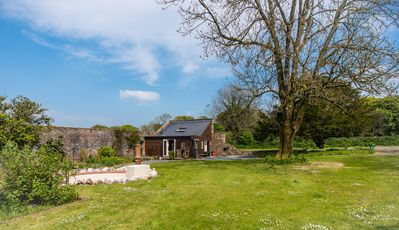 Nestled in 3/4 acre of private garden within a 3 acre Victorian Walled Garden