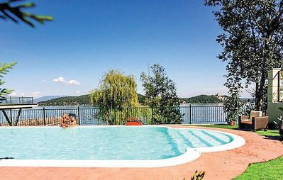 Photo for Villa Diaspro C: A bright and sunny one-story apartment located right on the Lake Maggiore, with Free WI-FI.