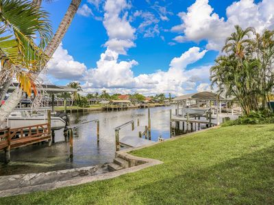 Photo for Spacious Mid Island Waterfront Pool Home Just a 2 Minute Walk To the Beach