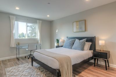 The master bedroom features an en-suite bathroom and work space.