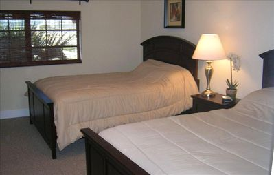 Master bedroom with two queen beds