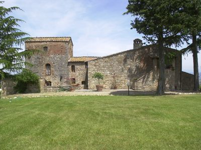 Photo for Villa Torre with swimming pool and tennis court and views of San Gimignano