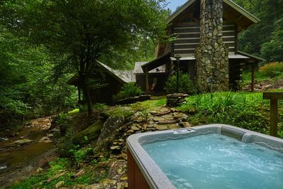 Sit in our salt water hot tub while listening to the relaxing creek waters.