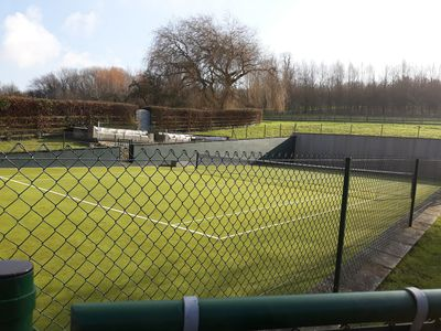 Beautifully maintained tennis court.