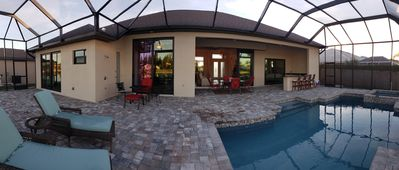 Photo for Luxurious/Modern/Brand New Home on canal in SW Florida with heated pool and spa