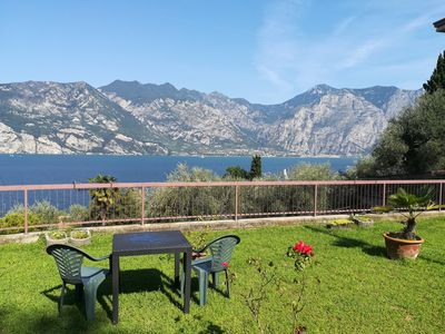 Photo for Apartment with spectacular lake view, large garden
