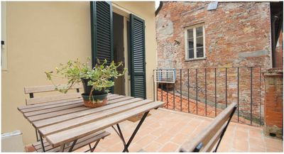Photo for Classic apartment with terrace in the heart of the walled city