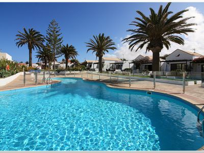 Photo for Superb air conditioned bungalow in beautiful setting, close to the sea and town