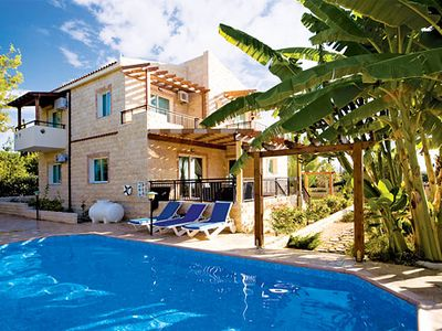 Photo for Modern villa with beautiful sea-views, a pool, gardens and Wi-Fi, close to town