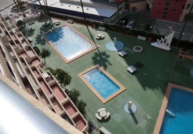 The three pools of the apartment complex as seen from the terrace