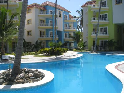 Palm Suites Community Pool with Condo in the Background (Blue Building)