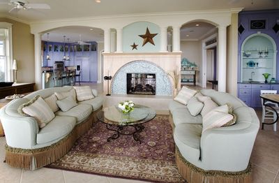 Living Room has wet Bar, ocean views, two porches (one screened). Outdoor dining