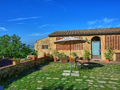 Photo for Cosy apartment with pool, WIFI, TV, pets allowed, panoramic view and parking, close to San Gimig...