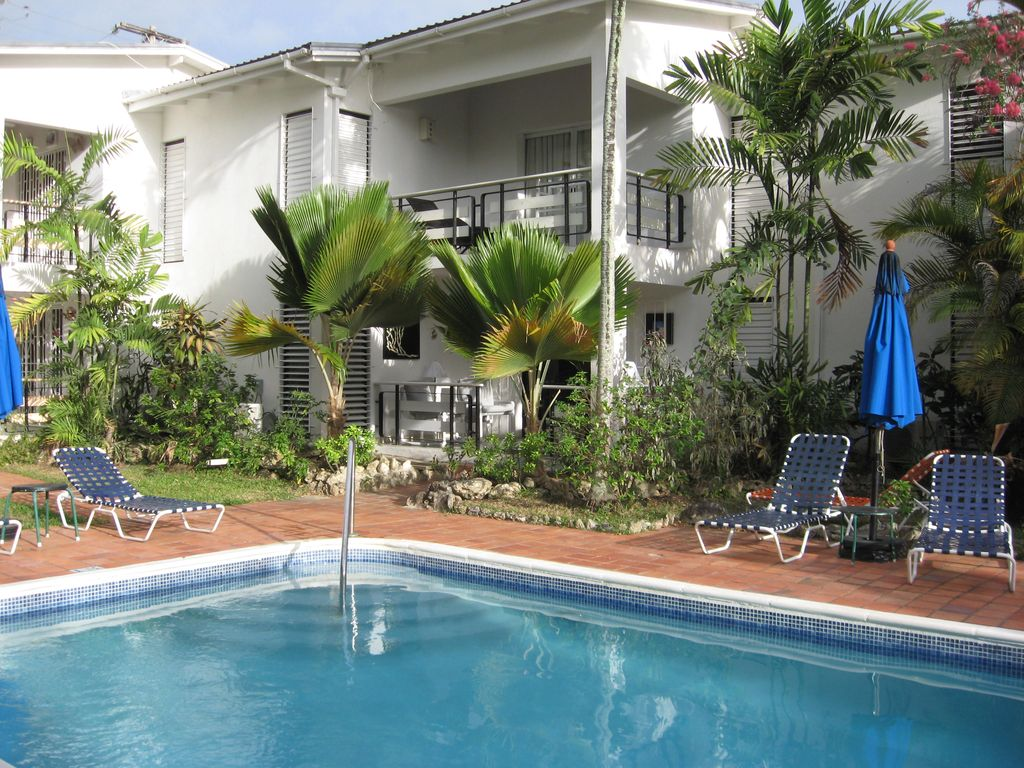 Poolside Bed beachfront + pool - one bedroom stylish - homeaway lascelles