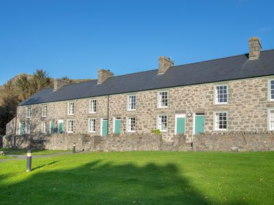 Photo for A haven of peace and tranquillity, this Victorian period holiday cottage has sea and forest views, a