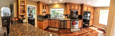 Gourmet kitchen with gas stove and granite counters.  Bar seating for 5.