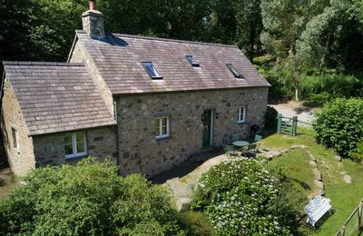 Photo for The cottage is nestled in woodland and overlooking a field  on The Bodnant Estate near Conwy.