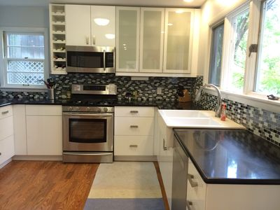 New kitchen with high end stainless steel appliances and classic farm sink.