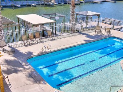 Photo for Waterfront condo with pool, dock access & panoramic views