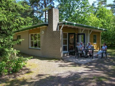 Photo for Bungalow in the middle of the forest, in versatile and spacious holiday park.